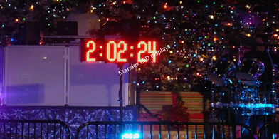 Digital LED counter on stand counts down in hours/minutes/seconds
